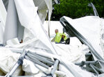FILE - In this May 2, 2009, file photo, rescue workers look over the collapsed canopy that covered the Dallas Cowboys indoor football facility in Irving, Texas. Jacksonville Jaguars special teams coordinator Joe DeCamillis, reflected on his time in Dallas. It was one eight coaching stops, and most painful,  during a 30-year NFL career. DeCamillis was inside Dallas' 86-foot-tall practice facility that collapsed during a thunderstorm in May 2009 injuring 12. (AP Photo/Tony Gutierrez, File)