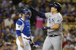 Tampa Bay Rays' Ji-Man Choi, right, celebrates next to Los Angeles Dodgers catcher Will Smith after a home run during the sixth inning of a baseball game in Los Angeles, Tuesday, Sept. 17, 2019. (AP Photo/Chris Carlson)