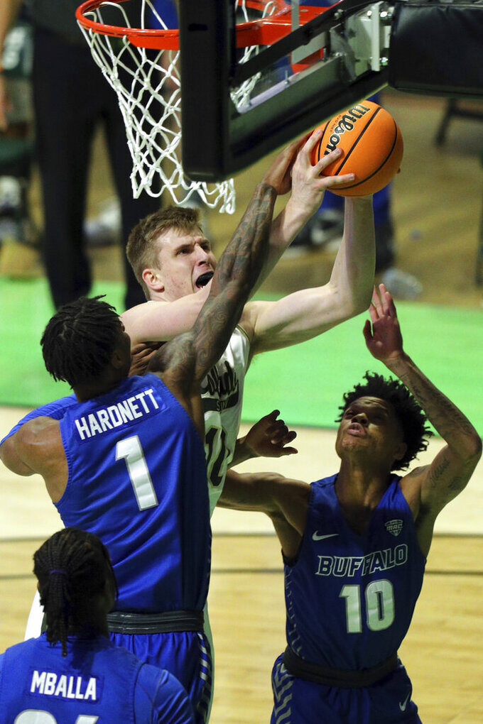 Colorado State forward James Moors (10) grabs a rebound from Buffalo forward LaQuill Hardnett (1) and guard Ronaldo Segu (10) during the first half of an NCAA college basketball game in the NIT, Friday, March 19, 2021, in Denton, Texas. (AP Photo/Richard W. Rodriguez)