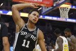 San Antonio Spurs guard Bryn Forbes (11) reacts after scoring against the Golden State Warriors during the second half of an NBA basketball game in San Francisco, Friday, Nov. 1, 2019. (AP Photo/Jeff Chiu)