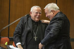 Archbishop Charles J. Chaput, left, and Archbishop-elect Nelson J. Perez, right, share a happy moment after they embraced during the press conference announcing Perez as the Archbishop-elect of Philadelphia on Thursday, January 23, 2020.  (Michael Bryant/The Philadelphia Inquirer via AP)