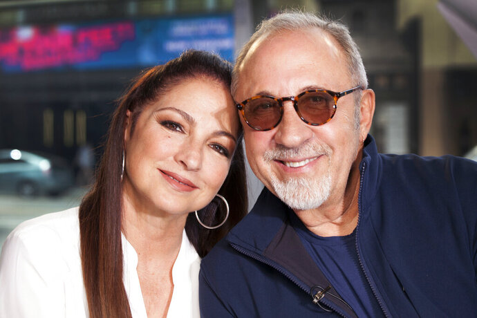 FILE - In this July 9, 2018 file photo, Gloria and Emilio Estefan pose for a portrait at BiteSize Studio in Los Angeles. The Estefans will receive the Library of Congress Gershwin Prize for Popular Song in May. They are the first married couple and musicians-songwriters of Hispanic descent to receive the honor. (Photo by Rebecca Cabage/Invision/AP, File)