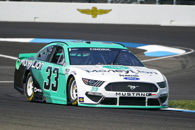 Austin Cindric (33) drives through a turn during practice for the NASCAR Cup Series auto race at Indianapolis Motor Speedway in Indianapolis, Saturday, Aug. 14, 2021. (AP Photo/Michael Conroy)