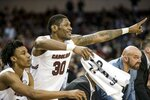 South Carolina forward Chris Silva (30) celebrates a defensive stop against Auburn during the first half of an NCAA college basketball game Tuesday, Jan. 22, 2019, in Columbia, S.C. (AP Photo/Sean Rayford)