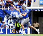 Memphis quarterback Seth Henigan (14) rolls out of the pocket to complete a pass against Mississippi State during an NCAA college football game Saturday, Sept. 18, 2021, in Memphis, Tenn. (Patrick Lantrip/Daily Memphian via AP)