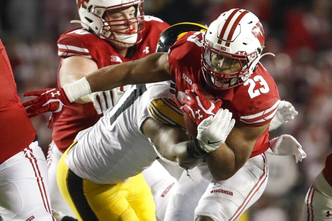 Wisconsin's Jonathan Taylor runs during the second half of an NCAA college football game against Iowa Saturday, Nov. 9, 2019, in Madison, Wis. Wisconsin won 24-22. (AP Photo/Morry Gash)