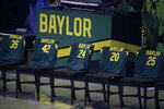 Chairs are draped with jerseys of the Baylor Immortal Ten. The 10 players and staff on the basketball team were killed in a bus crash struck by a train on there way to play the Texas Longhorns in January 22, 1927. in the first half of an NCAA college basketball game against Kansas State, Wednesday, Jan. 27, 2021, in Waco, Texas. (AP Photo/Jerry Larson)