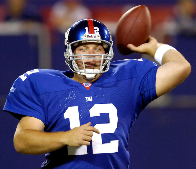 FILE - In this Aug. 17, 2006, file photo, New York Giants quarterback Jared Lorenzen passes the ball in the fourth quarter against the Kansas City Chiefs during an NFL preseason football game in East Rutherford, N.J. Lorenzen, a husky left-handed quarterback who set multiple Kentucky passing and offensive records before backing up Eli Manning on the Giants' Super Bowl-winning 2007 team, has died. He was 38. A release from the school said Lorenzen's family announced his death on Wednesday, (AP Photo/Bill Kostroun, File)