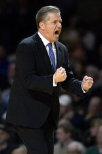 Kentucky head coach John Calipari reacts after his team was called for a foul against Vanderbilt during the second half of an NCAA college basketball game Tuesday, Feb. 11, 2020, in Nashville, Tenn. Kentucky won 78-64. (AP Photo/Mark Zaleski)