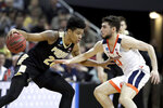 Purdue's Nojel Eastern (20) is defended by Virginia's Ty Jerome (11) during the first half of the men's NCAA Tournament college basketball South Regional final game, Saturday, March 30, 2019, in Louisville, Ky. (AP Photo/Michael Conroy)