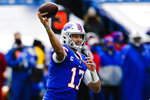 FILE - In this Nov. 1, 2020, file photo, Buffalo Bills quarterback Josh Allen (17) throws a pass during the first half of an NFL football game against the New England Patriots in Orchard Park, N.Y. Allen and the AFC East-leading Bills prepare to host the rookie Justin Herbert-led Chargers on Sunday in a showdown of the NFL's two leaders in yards passing.  (AP Photo/John Munson, File)