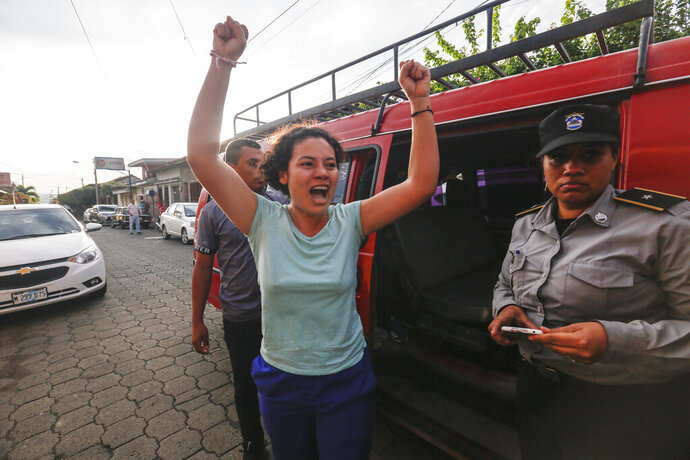 Opposition member María Adilia Peralta Cerratos raises her arms in jubilation as she returns home after being in prison, in Masaya, Nicaragua, Monday, May 20, 2019. Peralta Cerratos is one of 100 prisoners the Nicaraguan government released Monday in a form of house arrest, including three human rights activists. (AP Photo/Alfredo Zuniga)