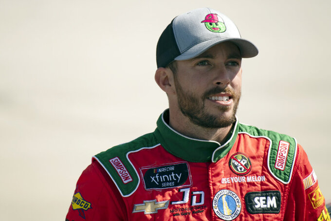 Driver Ross Chastain waits to get into his car before qualifying for the  NASCAR Xfinity Series auto race, Saturday, Oct. 5, 2019, in Dover, Del. (AP Photo/Brien Aho)