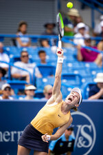 Simona Halep of Romania serves to Ekaterina Alexandrova of Russia on Center Court at the Western & Southern Open Wednesday, Aug. 14, 2019 in Mason, Ohio. Halep advanced in three sets 3-6, 7-5, 6-4. (Meg Vogel/The Cincinnati Enquirer via AP)