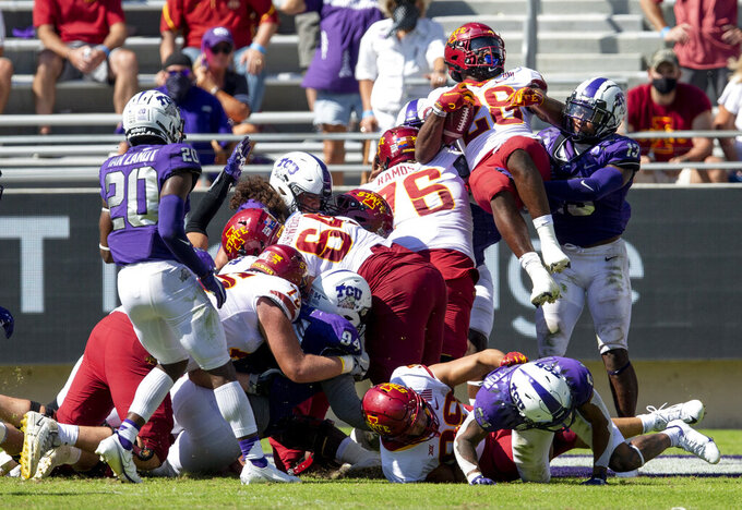 Iowa State running back Breece Hall (28) leaps over a pile of players to score a touchdown during an NCAA college football game against TCU on Saturday, Sept. 26, 2020 in Fort Worth, Texas. Iowa won 37-34. (AP Photo/Brandon Wade)