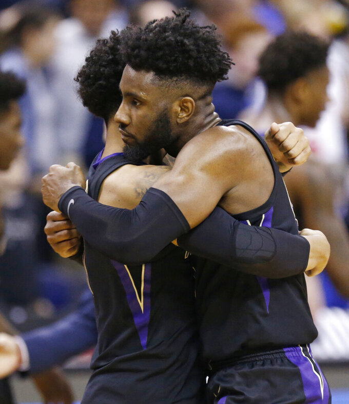 Washington's Jaylen Nowell, right, hugs David Crisp after they defeated Utah State during a first round men's college basketball game in the NCAA Tournament in Columbus, Ohio, Friday, March 22, 2019. (AP Photo/Paul Vernon)