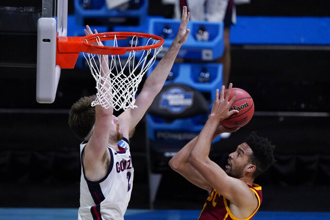 Southern California forward Isaiah Mobley, right, shoots over Gonzaga forward Drew Timme, left, during the first half of an Elite 8 game in the NCAA men's college basketball tournament at Lucas Oil Stadium, Tuesday, March 30, 2021, in Indianapolis. (AP Photo/Darron Cummings)