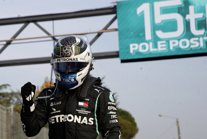 FILE - In this Saturday, Oct. 31, 2020 file photo, Mercedes driver Valtteri Bottas of Finland celebrates after clocking the fastest time during qualification ahead of Sunday's Emilia Romagna Formula One Grand Prix, at the Enzo and Dino Ferrari racetrack, in Imola, Italy. The new season starts Sunday March 28, 2021 with the Bahrain Grand Prix and ends in December 2021 at Abu Dhabi. (AP Photo/Luca Bruno, Pool, File)