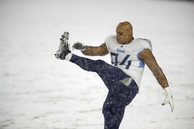 Tennessee Titans' Jack Crawford warms up before an NFL football game against the Green Bay Packers Sunday, Dec. 27, 2020, in Green Bay, Wis. (AP Photo/Matt Ludtke)