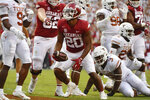 Arkansas running back Dominique Johnson (20) celebrates after scoring a touchdown against Texas during the first half of an NCAA college football game Saturday, Sept. 11, 2021, in Fayetteville, Ark. (AP Photo/Michael Woods)