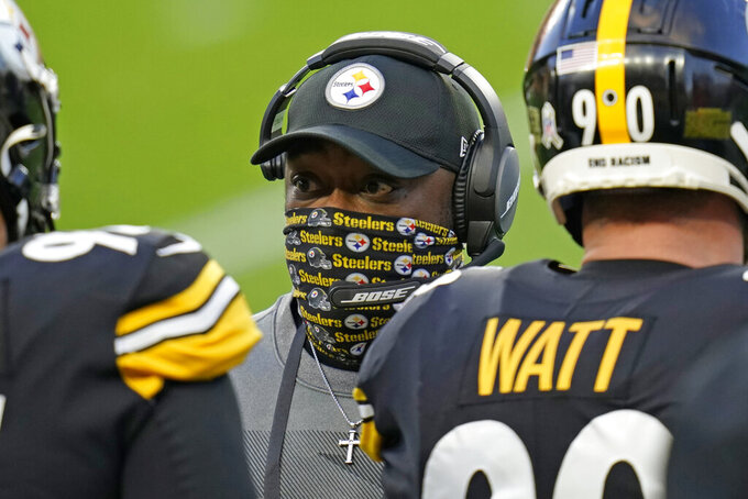Pittsburgh Steelers head coach Mike Tomlin, center, talks to players on the sideline during the first half of an NFL football game against the Cincinnati Bengals, Sunday, Nov. 15, 2020, in Pittsburgh. (AP Photo/Keith Srakocic)