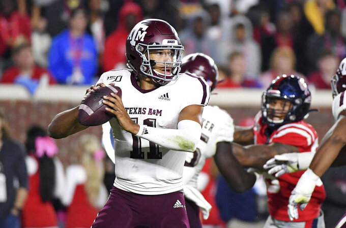 Texas A&M quarterback Kellen Mond (11) looks to pass during the first half of an NCAA college football game against Mississippi in Oxford, Miss., Saturday, Oct. 19, 2019. (AP Photo/Thomas Graning)