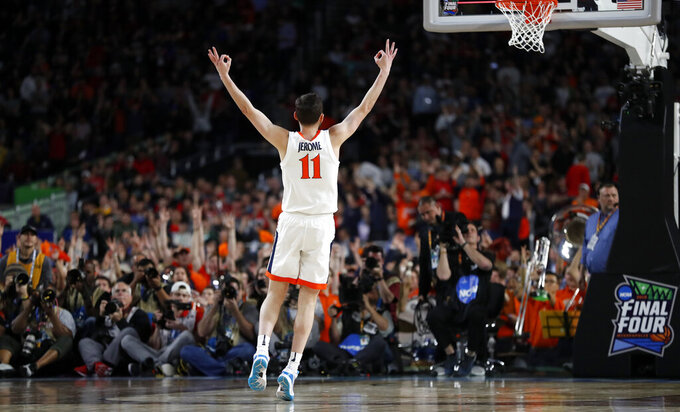 Virginia's Ty Jerome (11) reacts after shooting a 3-point basket during the first half in the championship of the Final Four NCAA college basketball tournament against Texas Tech, Monday, April 8, 2019, in Minneapolis. (AP Photo/Jeff Roberson)