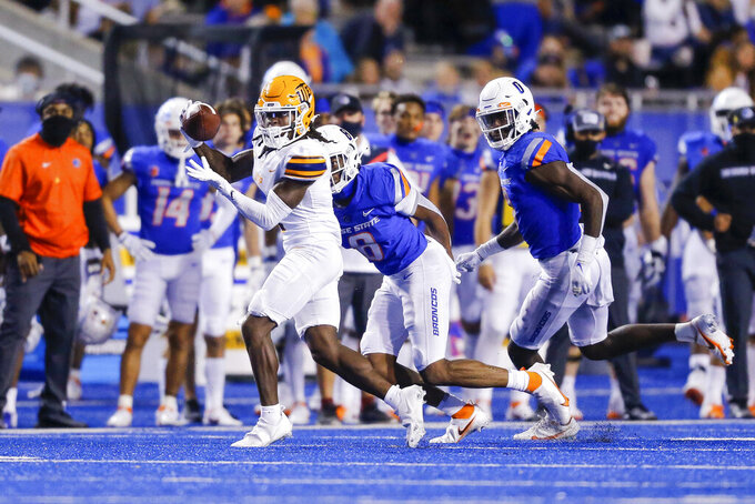 UTEP wide receiver Tyrin Smith (1) reaches for a pass as Boise State cornerback Markel Reed (8) and safety JL Skinner, right, close in during the second half of an NCAA college football game Friday, Sept. 10, 2021, in Boise, Idaho. (AP Photo/Steve Conner)