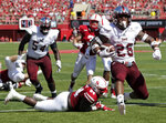 FILE - In this Saturday, Sept. 15, 2018, file photo, Troy running back B.J. Smith (26) runs into the end zone for a touchdown past Nebraska defensive lineman Khalil Davis (94) in the first half of an NCAA college football game in Lincoln, Neb. After big wins in previous seasons, Troy haven't been able to maintain that momentum. Fresh from a 24-19 upset of Nebraska, the Trojans open Sun Belt play Saturday night at Louisiana-Monroe.  (AP Photo/Nati Harnik, File)