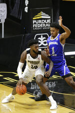 Purdue forward Trevion Williams (50) dribbles under the net against Indiana State's center Tre Williams (1) during the second half of an NCAA men's basketball game, Saturday, Dec. 12, 2020, in West Lafayette, Ind. (Nikos Frazier/Journal & Courier via AP)