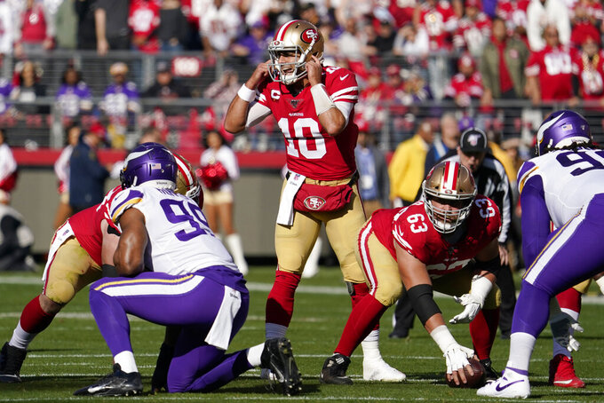 San Francisco 49ers quarterback Jimmy Garoppolo (10) calls to his team at the line of scrimmage during the first half of an NFL divisional playoff football game against the Minnesota Vikings, Saturday, Jan. 11, 2020, in Santa Clara, Calif. (AP Photo/Tony Avelar)