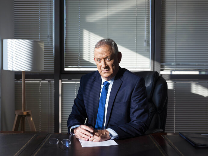 In this Thursday, Sept. 12, 2019 photo, Blue and White party leader and former IDF chief of staff Benny Gantz poses for a portrait at his party headquarters, in Tel Aviv, Israel. (AP Photo/Oded Balilty)