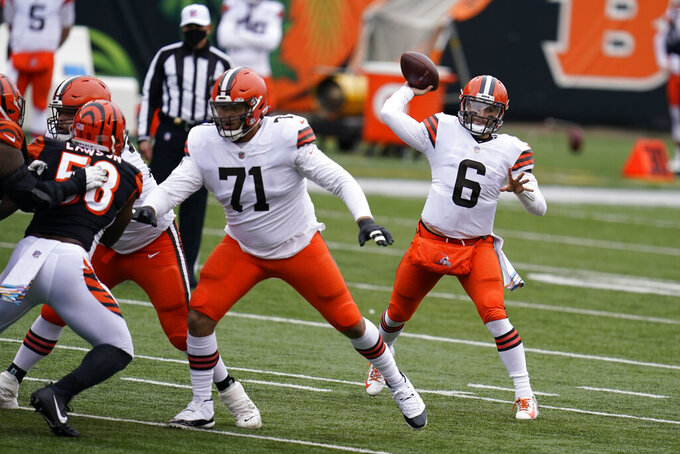 Cleveland Browns quarterback Baker Mayfield (6) throws during the first half of an NFL football game against the Cincinnati Bengals, Sunday, Oct. 25, 2020, in Cincinnati. (AP Photo/Michael Conroy)
