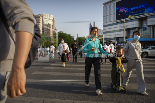 APTOPIX Virus Outbreak China Daily Life