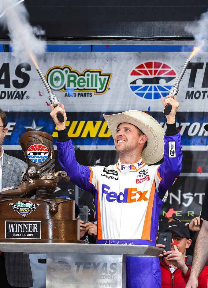 Driver Denny Hamlin celebrates in victory lane after winning a NASCAR Cup auto race at Texas Motor Speedway, Sunday, March 31, 2019, in Fort Worth, Texas. (AP Photo/Larry Papke)