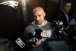 New England Patriots running back Rex Burkhead faces reporters in the team's locker room at Gillette Stadium, Monday, Sept. 9, 2019, in Foxborough, Mass. (AP Photo/Steven Senne)