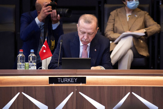 Turkey's President Recep Tayyip Erdogan attends a plenary session during a NATO summit at NATO headquarters in Brussels, Monday, June 14, 2021. U.S. President Joe Biden is taking part in his first NATO summit, where the 30-nation alliance hopes to reaffirm its unity and discuss increasingly tense relations with China and Russia, as the organization pulls its troops out after 18 years in Afghanistan. (Brendan Smialowski, Pool via AP)