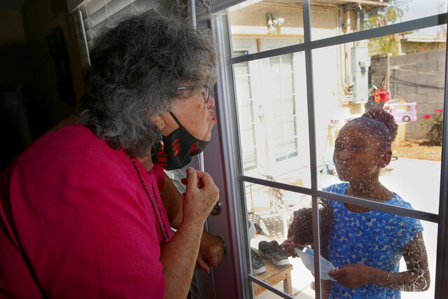 Zita Robinson, left, who's 77 and diabetic, blows a kiss to her granddaughter Traris