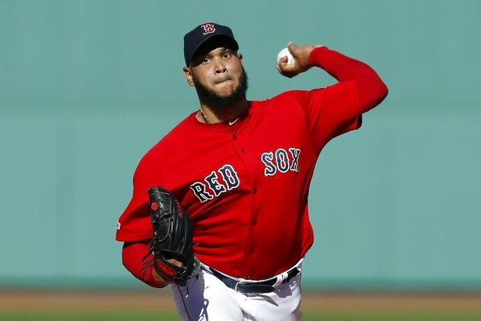 FILE - In this Sept. 29, 2019, file photo, Boston Red Sox's Eduardo Rodriguez pitches during the first inning of a baseball game against the Baltimore Orioles in Boston. Rodríguez will miss the entire season because of heart inflammation caused by COVID-19. He has been on the injured list since mid-July and has not pitched this season. (AP Photo/Michael Dwyer, File)