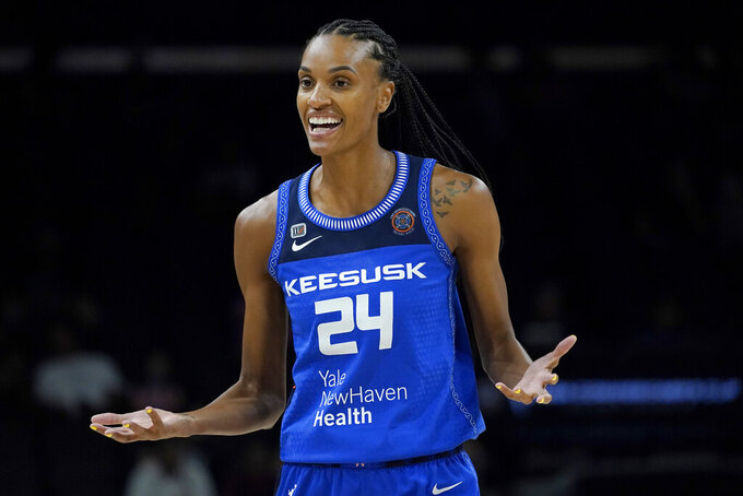 Connecticut Sun forward DeWanna Bonner (24) reacts toward= a referee after a turnover during the first half of the Commissioner's Cup WNBA basketball game against the Seattle Storm, Thursday, Aug. 12, 2021, in Phoenix. (AP Photo/Matt York)