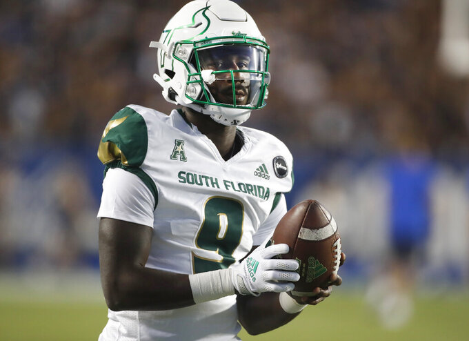 South Florida quarterback Timmy McClain warms up before an NCAA college football game against BYU, Saturday, Sept. 25, 2021, in Provo, Utah. (AP Photo/George Frey)