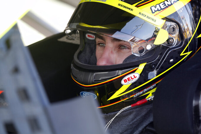 NASCAR Cup Series driver Ryan Blaney (12) waits in his car before a NASCAR Cup Series auto race at the Las Vegas Motor Speedway Sunday, Sept. 26, 2021, in Las Vegas. (AP Photo/Steve Marcus)