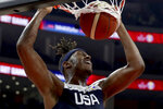 United States' Myles Turner dunks during a consolation playoff game against Serbia for the FIBA Basketball World Cup in Dongguan in southern China's Guangdong province on Thursday, Sept. 12, 2019. The U.S. will leave the World Cup with its worst finish ever in a major international tournament, assured of finishing no better than seventh after falling to Serbia 94-89 in a consolation playoff game on Thursday night. (AP Photo/Ng Han Guan)