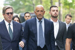 Tom Barrack, center, arrives at Brooklyn federal court, Monday, July 26, 2021, in New York. Barrack was among three men charged in New York federal court with trying to influence foreign policy while Donald Trump was running in 2016 and later while president. The chair of former President Donald Trump's 2017 inaugural committee allegedly conspired to influence U.S. policy to benefit the United Arab Emirates, even while he was seeking a position as an American diplomat. (AP Photo/Mark Lennihan)