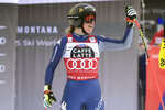 Italy's Sofia Goggia celebrates at the finish area of an alpine ski, women's World Cup downhill in Crans Montana, Switzerland, Saturday, Jan. 23, 2021.(AP Photo/Marco Tacca)