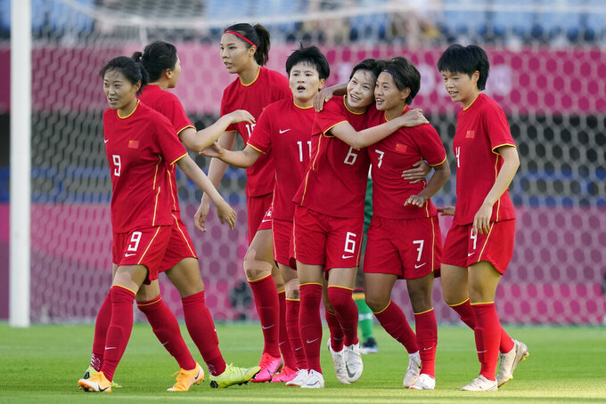 China's Wang Shuang (7) celebrates with her teammates after scoring a goal against Zambia during a women's soccer match at the 2020 Summer Olympics, Saturday, July 24, 2021, in Miyagi, Japan. (AP Photo/Andre Penner)