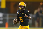 Arizona State quarterback Jayden Daniels runs for a first down against Colorado during the first half of an NCAA college football game Saturday, Sept. 21, 2019, in Tempe, Ariz. (AP Photo/Rick Scuteri)