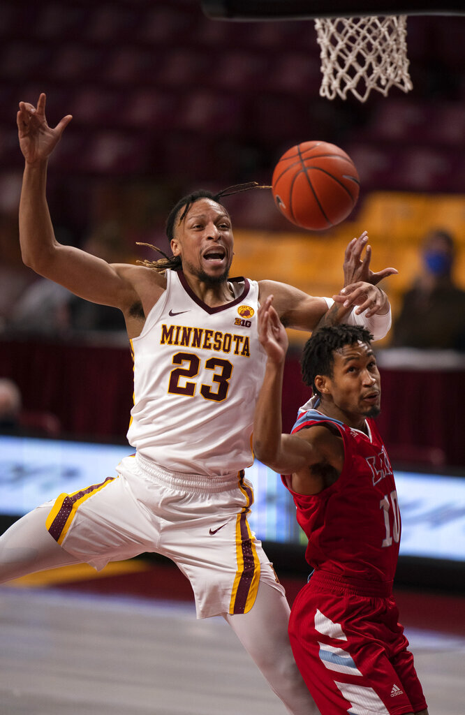 Minnesota forward Brandon Johnson (23) cannot grab a long pass under the net as he is guarded by Loyola Marymount guard Quentin Jackson Jr. (10) in the first half of an NCAA college basketball game Monday, Nov. 30, 2020, in Minneapolis. (Jeff Wheeler/Star Tribune via AP)