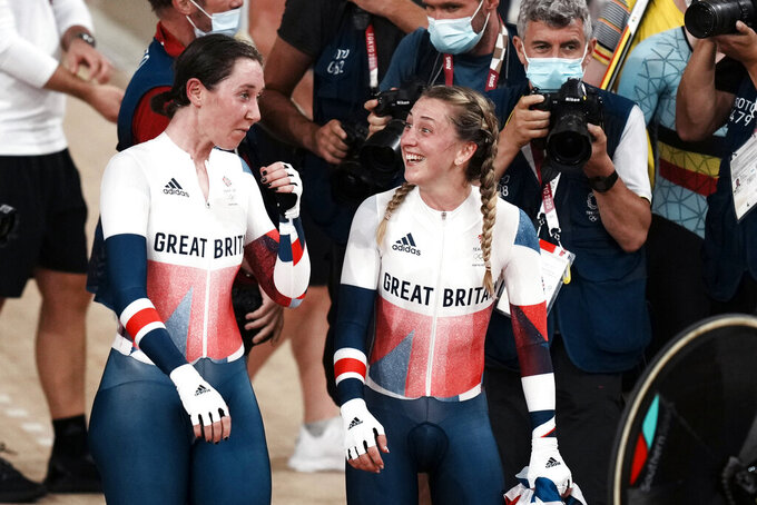 Laura Kenny, right, and Kate Archibald, of Team Britain, react after winning the gold medal in the women's madison race at the 2020 Summer Olympics, Friday, Aug. 6, 2021, in Izu, Japan. (AP Photo/Thibault Camus)