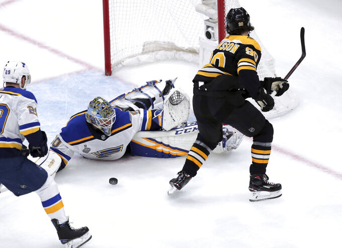 St. Louis Blues goaltender Jordan Binnington, left, stops a shot by Boston Bruins' Marcus Johansson, right, of Sweden, during the first period in Game 7 of the NHL hockey Stanley Cup Final, Wednesday, June 12, 2019, in Boston. (AP Photo/Charles Krupa)